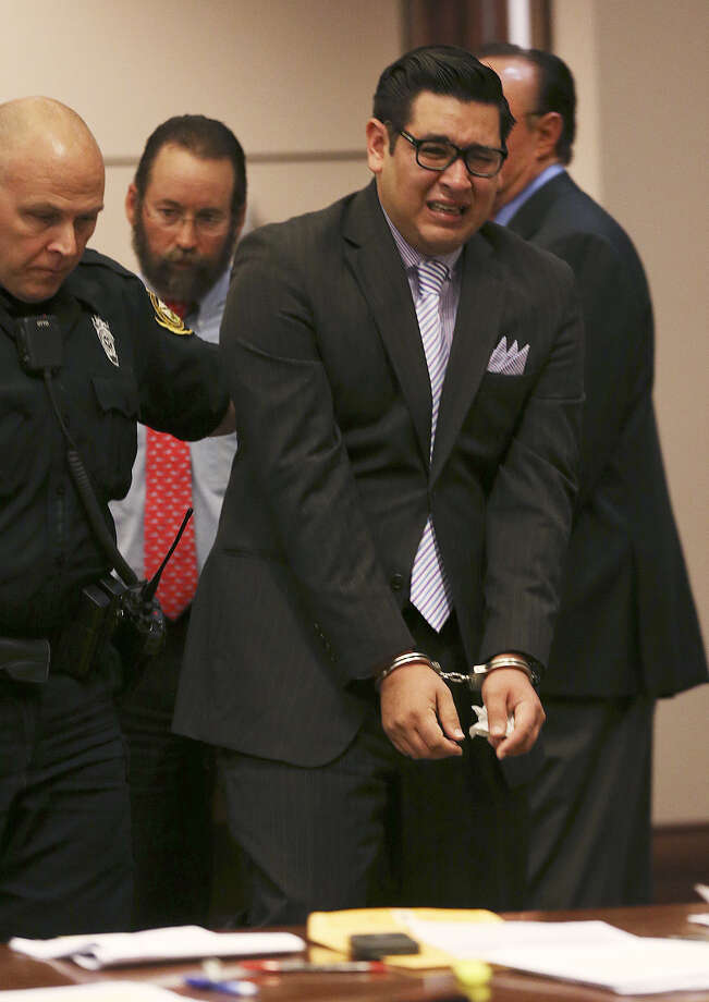 Kevin Balditt, 27, is led out of the courtroom after being sentenced for causing the Jan. 22, 2011, crash that severed the leg of a policeman who had stopped to help people with a flat tire. Photo: Photos By Jerry Lara / San Antonio Express-News / @San Antonio Express-News