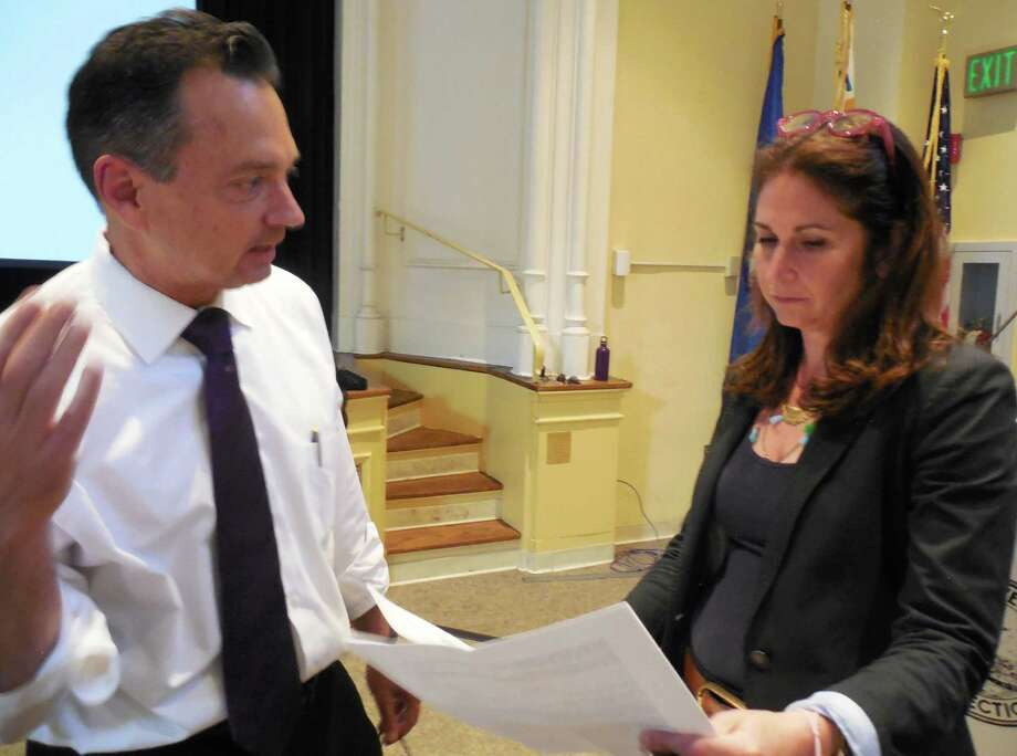 "Mark Keener, of the RBA consulting group, and Melissa Kane, chairman of the Downtown Steering Committee, go over results of the recent ""Your Downtown"" resident survey conducted by RBA. Results were presented during a meeting Monday in Town Hall. Photo: Anne M. Amato / westport news"