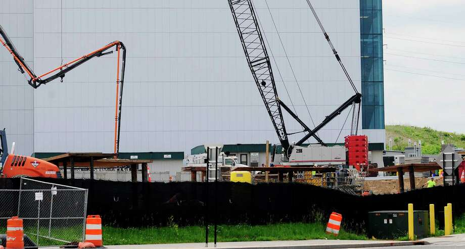Construction work continues as a new building is being built at the College of Nanoscale Science and Engineering campus on Tuesday, June 10, 2014, in Albany, N.Y.  (Paul Buckowski / Times Union) Photo: Paul Buckowski