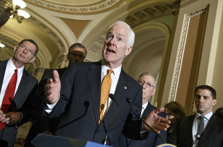 Senate Minority Whip John Cornyn (foreground) and Rep. Henry Cuellar have authored legislation to speed removal of Central American youth flowing over the U.S.-Mexico border. Photo: J. Scott Applewhite / Associated Press / AP