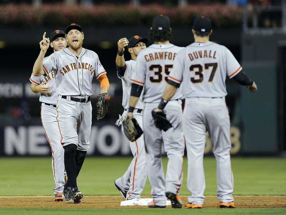 Hunter Pence, trailed by Tyler Colvin, celebrates the Giants' 7-4 victory with Gregor Blanco (center), Brandon Crawford and Adam Duvall. Duvall hit a go-ahead homer in the sixth inning. Photo: Michael Perez, Associated Press