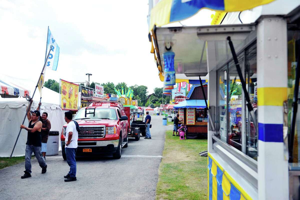 Workers set up the food booths at the Saratoga County Fair on Monday, July 21, 2014, in Ballston Spa, N.Y. The fair opens on Tuesday. (Paul Buckowski / Times Union)