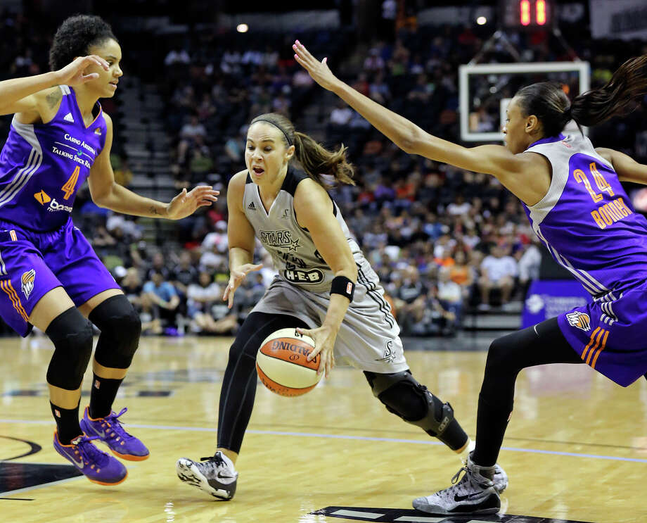 San Antonio Stars' Becky Hammon looks for room between Phoenix Mercury's Candice Dupree (left) and DeWanna Bonner during their WNBA game Saturday June 7, 2014 at the AT&T Center. The Mercury won in double overtime 91-79. Photo: San Antonio Express-News / © 2014 San Antonio Express-News