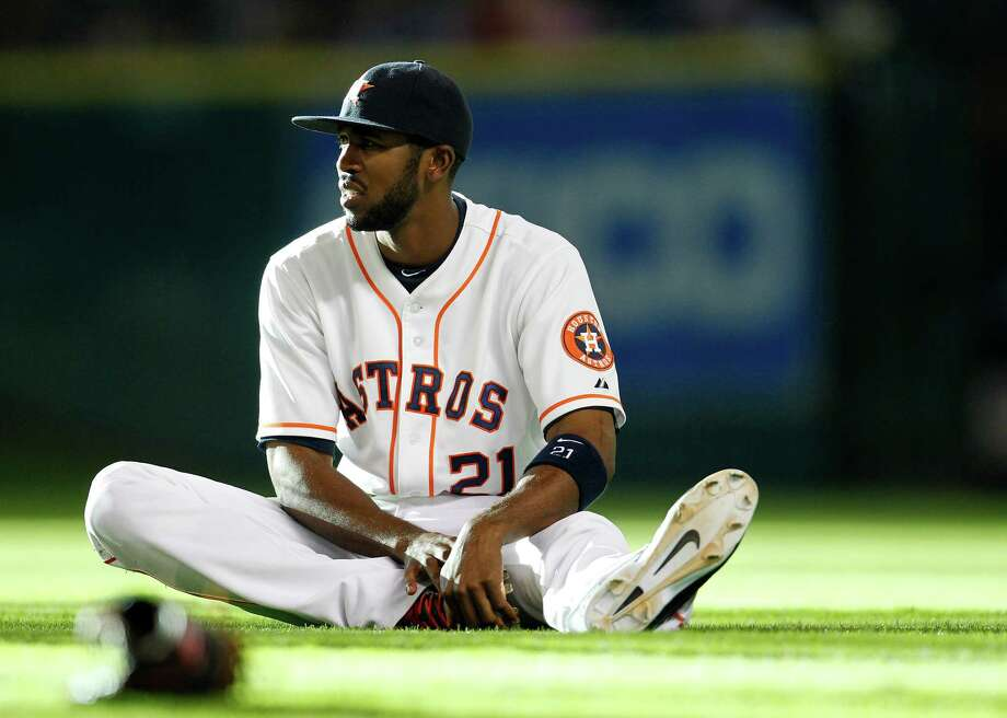 Astros center fielder Dexter Fowler has been relegated to a spectator for the team's last 19 games while recovering from a right intercostal strain. Photo: Karen Warren, Staff / © 2014 Houston Chronicle