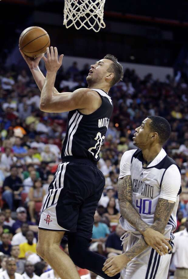 July 21: Kings 77, Rockets 68  Donatas Motiejunas goes up for a shot over Eric Moreland. Photo: John Locher, Associated Press