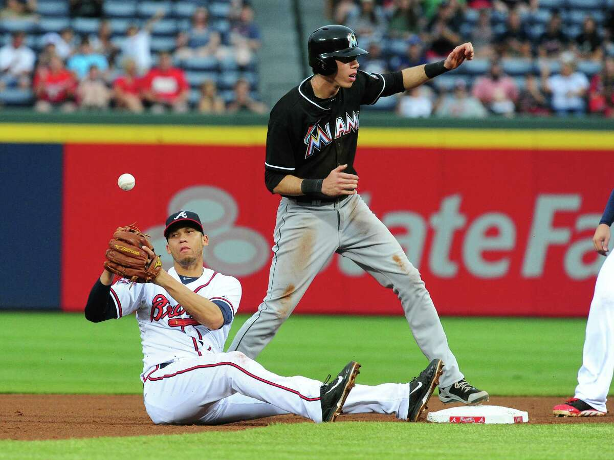 ATLANTA, GA - JULY 21: Andrelton Simmons #19 of the Atlanta Braves loses his grip on the ball after forcing out Christian Yelich #21 of the Miami Marlins at second base during the fourth inning at Turner Field on July 21, 2014 in Atlanta, Georgia. (Photo by Scott Cunningham/Getty Images) ORG XMIT: 477586609