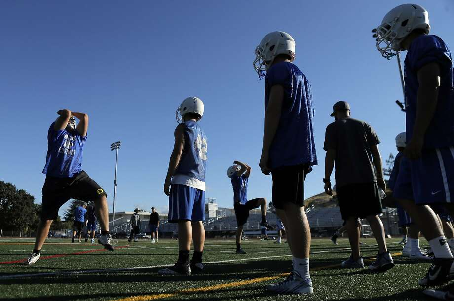 Varsity football players take part in non-impact tackling drills at Acalanes High School in Lafayette. A new law limits full-contact practice time, in response to alarm over head injuries suffered by young players. Photo: Carlos Avila Gonzalez, The Chronicle