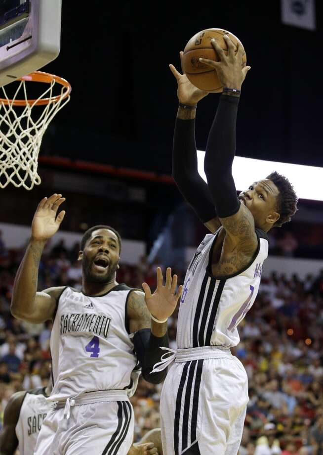 Ben McLemore, right, gets a rebound against the Rockets. Photo: John Locher, Associated Press