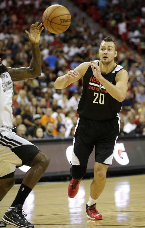 Donatas Motiejunas, right, loses the ball against the Kings. Photo: John Locher, Associated Press