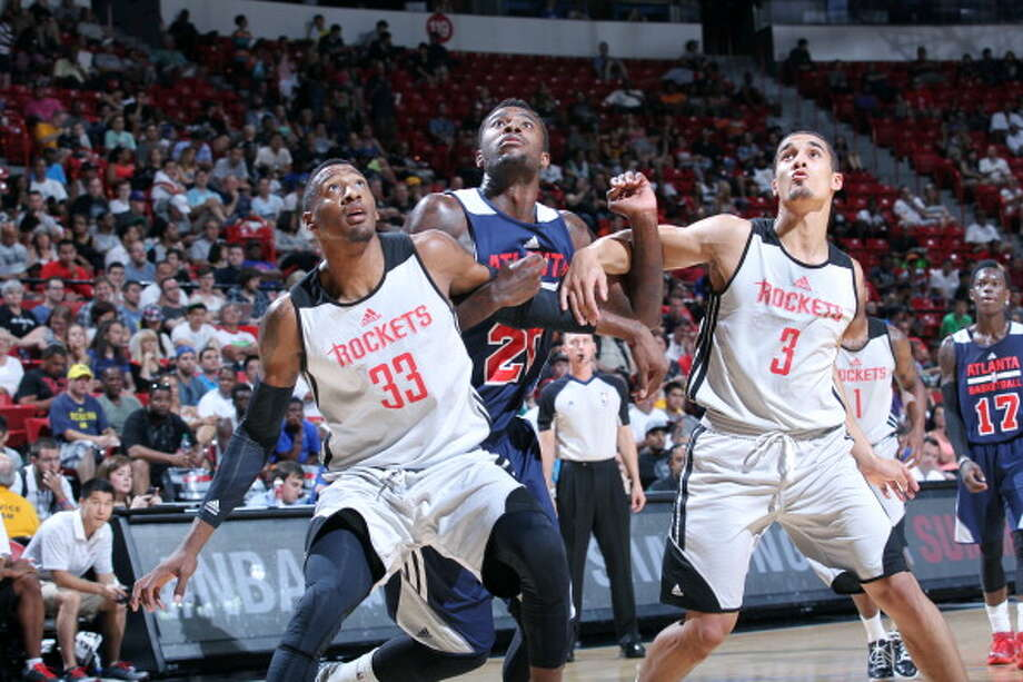 July 19: Rockets 78, Hawks 71  Robert Covington and Nick Johnson battle for position against D.J. Shelton. Photo: Jack Arent, NBAE/Getty Images / 2014 NBAE