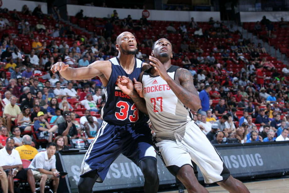 Tarik Black battles for position against Adreian Payne. Photo: Jack Arent, NBAE/Getty Images / 2014 NBAE