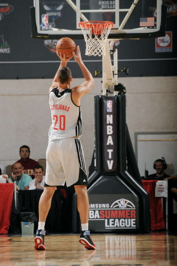 Donatas Motiejunas attempts a free throw. Photo: Bart Young, NBAE/Getty Images / 2014 NBAE