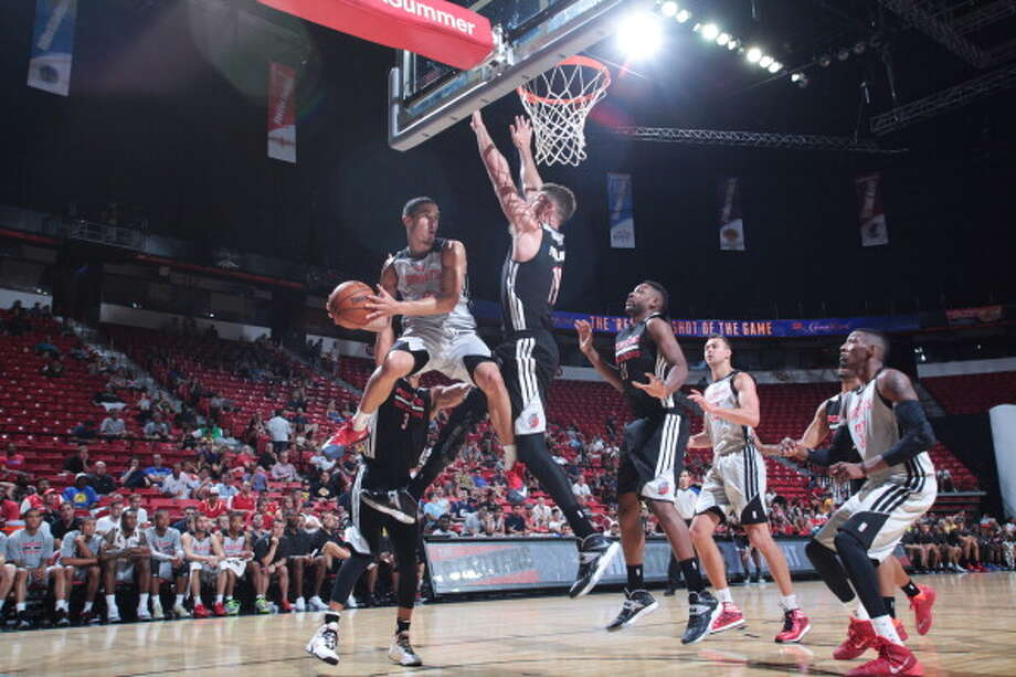 July 13: Blazers 75, Rockets 67  Nick Johnson looks to pass. Photo: Jack Arent, NBAE/Getty Images / 2014 NBAE