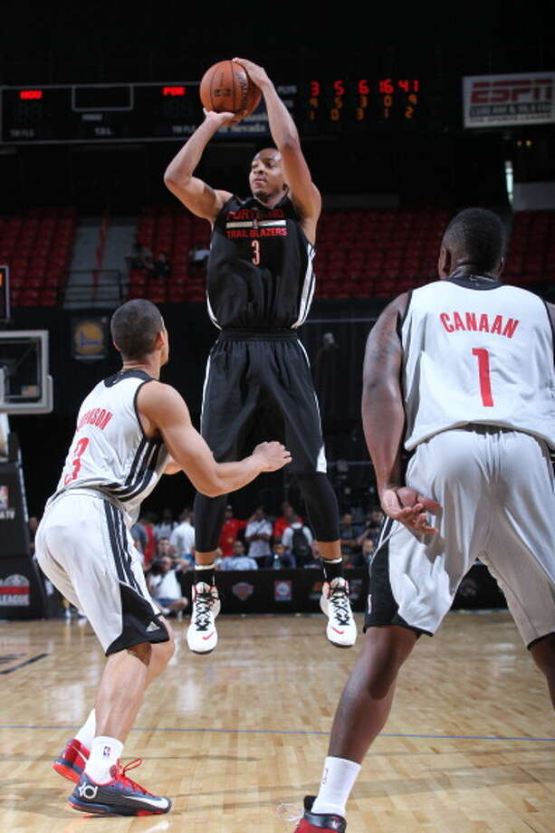 CJ McCollum takes a shot. Photo: Jack Arent, NBAE/Getty Images / 2014 NBAE