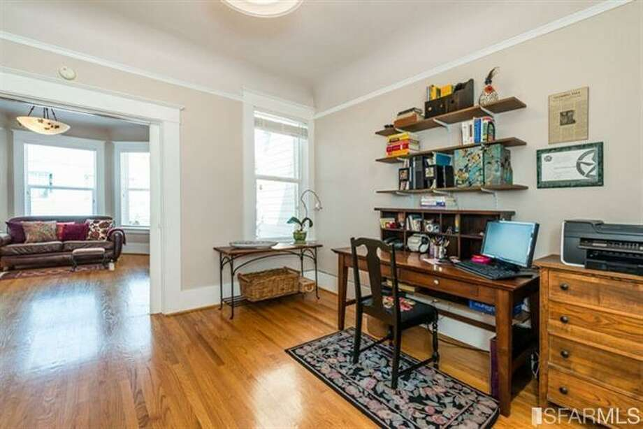 267 Anderson St., Unit A, Bernal Heights: The double parlor is counted as one of the three bedrooms. Photo: MLS