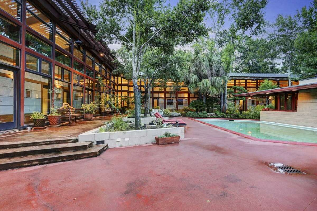 This modern Houston home is the perfect wooded retreat.
