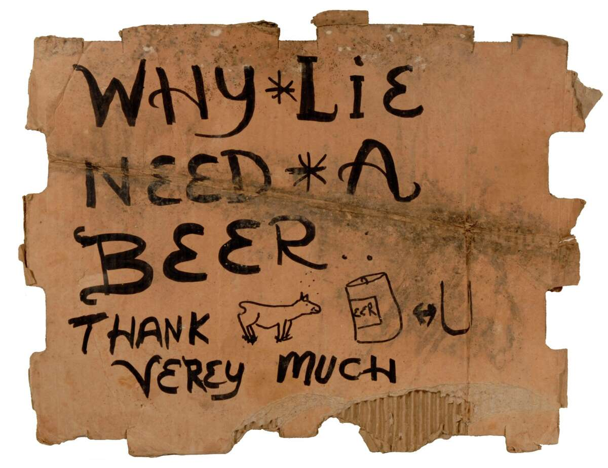 A cardboard sign purchased by Texas artist Willie Baronet.