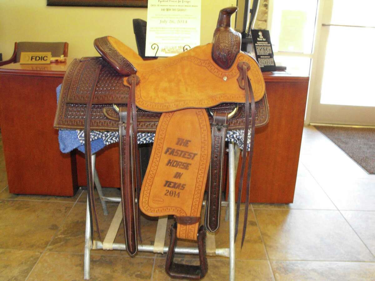 A ranch-roping saddle is included as the big award for the winner of the Fastest Horse in Texas 2014 competition, this Saturday in Bandera.