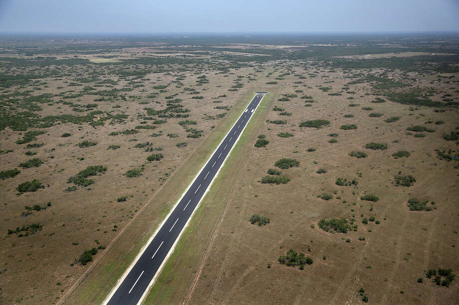 FALFURRIAS, TX - JULY 21:  An airstrip lies on the King Ranch near the U.S.-Mexico border on July 21, 2014 near Falfurrias, Texas. Thousands of immigrants, many of them minors from Central America, have crossed illegally into the United States this year, causing an unprecedented humanitarian crisis on the U.S.-Mexico border. Texas Governor Rick Perry announced that he will send 1,000 National Guard troops to help stem the flow. Photo: John Moore, Getty Images / 2014 Getty Images
