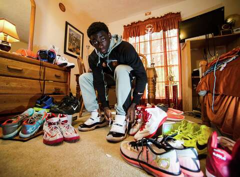 sale retailer 362b5 fa0f0 Jordan Hunter, an Ozen basketball player and sneaker aficionado, poses for  a picture with