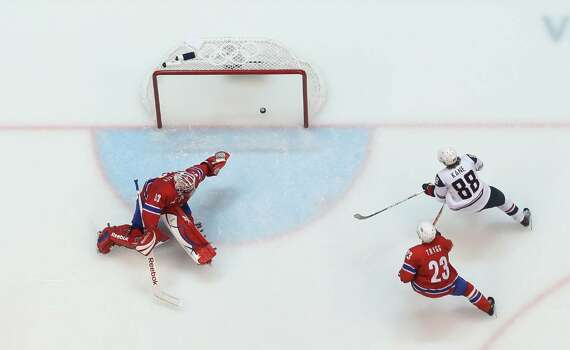 VANCOUVER, BC - FEBRUARY 18:  Patrick Kane (#88) of the United States scores a 2nd period goal on goalie Pal Grotnes of Norway during the ice hockey men's preliminary game between USA and Norway on day 7 of the 2010 Winter Olympics at Canada Hockey Place on February 18, 2010 in Vancouver, Canada. (Photo by Bruce Bennett/Getty Images) *** Local Caption *** Patrick Kane;Pal Grotnes Photo: Bruce Bennett, Getty Images / 2010 Getty Images