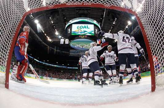 VANCOUVER, BC - FEBRUARY 18:  Golaie Pal Grotnes (L) of Norway watches as members of the United States hockey team celebrate a 1st period goal by Chris Drury during the ice hockey men's preliminary game between USA and Norway on day 7 of the 2010 Winter Olympics at Canada Hockey Place on February 18, 2010 in Vancouver, Canada.  (Photo by Julie jacobson-Pool/Getty Images) *** Local Caption *** Pal Grotnes Photo: Pool, Getty Images / 2010 Getty Images