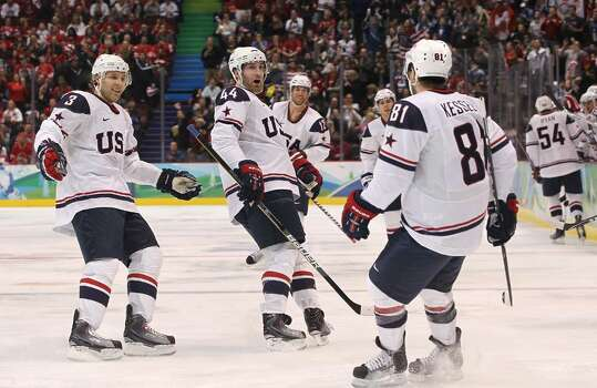 VANCOUVER, BC - FEBRUARY 18:  Phil Kessel #18 (L) of The United States celebrates with teammates after scoring the opening goal during the ice hockey men's preliminary game between USA and Norway on day 7 of the 2010 Winter Olympics at Canada Hockey Place on February 18, 2010 in Vancouver, Canada.  (Photo by Bruce Bennett/Getty Images) *** Local Caption *** Phil Kessel Photo: Bruce Bennett, Getty Images / 2010 Getty Images