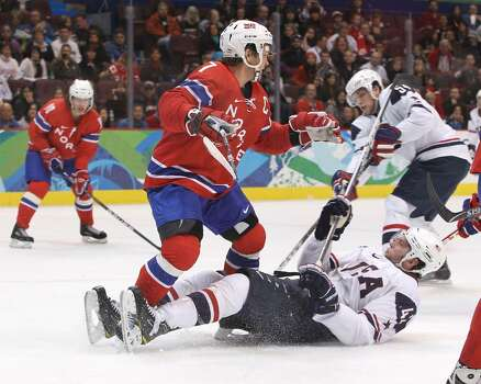VANCOUVER, BC - FEBRUARY 18:  David Backes of The United States is checked by Tommy Jakobsen of Norway during the ice hockey men's preliminary game between USA and Norway on day 7 of the 2010 Winter Olympics at Canada Hockey Place on February 18, 2010 in Vancouver, Canada.  (Photo by Bruce Bennett/Getty Images) *** Local Caption *** David Backes;Tommy Jakobsen Photo: Bruce Bennett, Getty Images / 2010 Getty Images