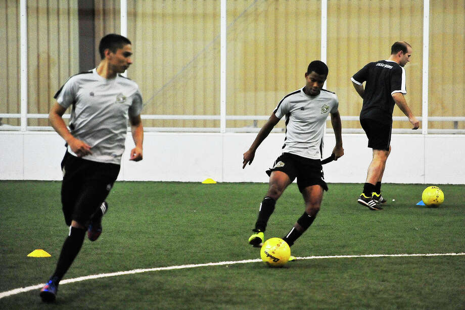 FILE - Texas Strikers midfielder Rico Keeling, center, practices passing excursuses during Wednesday nights practice at Cris Quinn Indoor Soccer Complex  Beaumont is home to the semi professional soccer team the Texas Strikers that competes in the Professional Arena Soccer League. Michael Rivera/@michaelrivera88