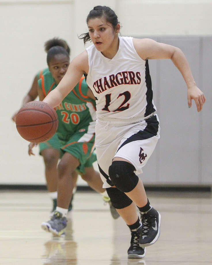 Churchill's Mikki Flores (right), playing against Sam Houston in December, has accepted  a scholarship to Texas A&M University-Corpus Christi. Photo: File Photo / Stone Oak Weekly / Prime Time Newspapers 2013