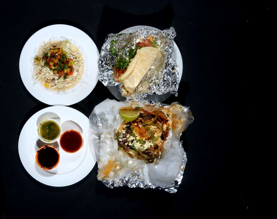 Clockwise from top left, a fish taco from Katherine and Company, a Baja taco from Fuzzy's Taco Shop and a red taco from Tacos La Bamba. Photo taken Friday, July 11, 2014 Guiseppe Barranco/@spotnewsshooter