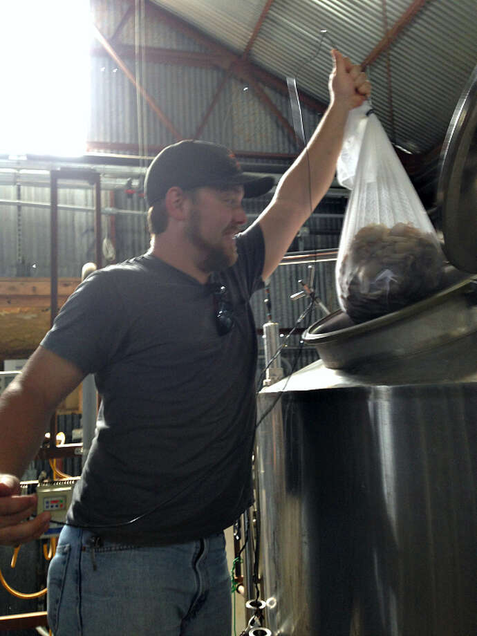 Oyster mushrooms being added after the boil by Jeremy Bastian of Logro Farms. (Jester King photo and caption.)