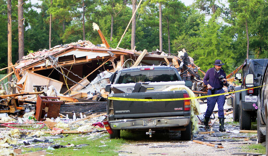 Investigators work a scene after a home exploded, Tuesday, July 22, 2014, in Willis, Texas. Three adults were flown by LifeFlight medical helicopter to Memorial Hermann-The Texas Medical Center. Details of their injuries were not released, but they were in critical condition, said Jason Oliphant, chief of Montgomery County Emergency Services District No. 1. Oliphant said the home was totally destroyed and small fires burned after the explosion, and it was unclear what sparked the blast. Photo: Cody Duty, Houston Chronicle / © 2014 Houston Chronicle