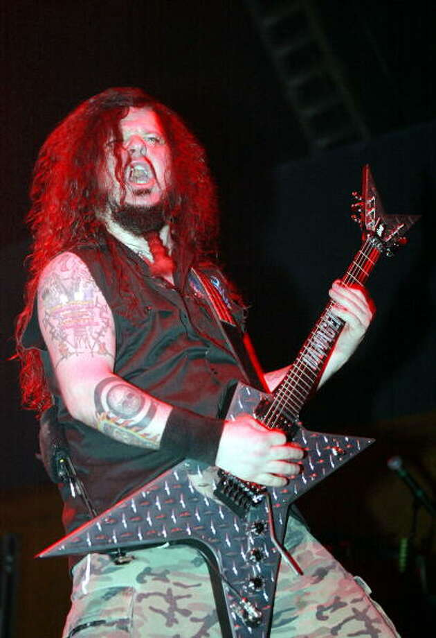 "2004: Ex-guitarist of the groove metal band Pantera, ""Darrell ""Dimebag"" Abbott, was murdered on stage by a gunman while performing with his new band."" Source: Wikipedia Photo: Scott Gries, Getty Images / 2004 Getty Images"