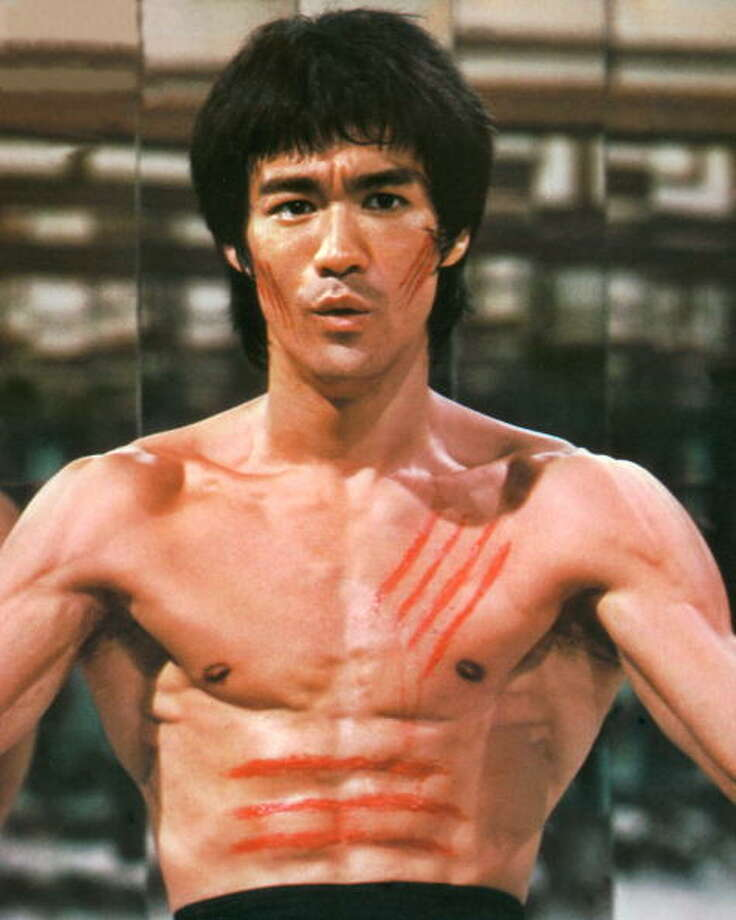 "1973: Bruce Lee was working on the ""film 'Enter The Dragon' when he passed out and died from an allergic reaction to a pain medication."" Source: Wikipedia Photo: Silver Screen Collection, Getty Images / 2006 Getty Images"