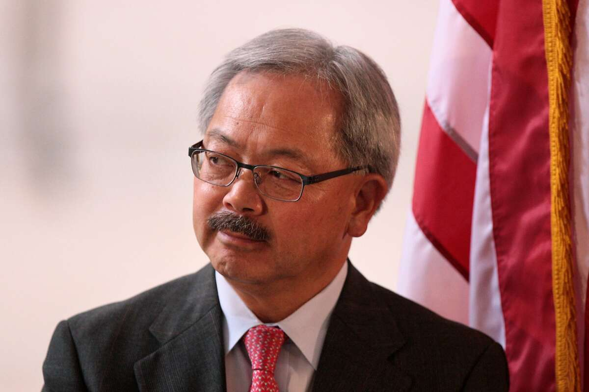 San Francisco Mayor Ed Lee watches PGA Tour Commissioner Tim Finchem speak at a City Hall press conference on Wednesday, July 2, 2014.