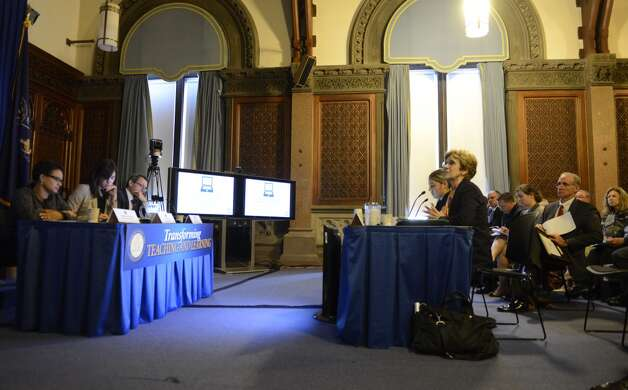 Ellen Meier, associate professor of computing and education at Columbia University, right, and Rita Sanchez, who joined Meier in her presentation, address panel members, left, during a Smart Schools Commission public symposium on how to enhance teaching and learning through technology Monday, July 21, 2014, at the Capitol in Albany, N.Y. The Smart Schools Commission is responsible for advising the State on how to best invest the proposed $2 billion Smart Schools Bond Act in order to enhance teaching and learning through technology. Photo: Will Waldron, Albany Times Union