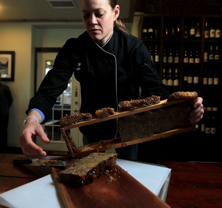 Jamie Zelko harvestes honey at Zelko Bistro in the Heights.   ( Karen Warren / Houston Chronicle ) Photo: Karen Warren, Houston Chronicle