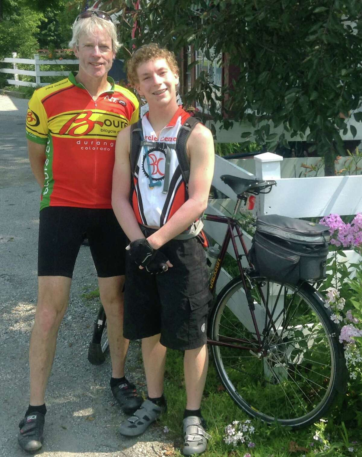 Tom O'Brien and his son, Jake, 16, of New Miilford pose Tuesday, July 22, 2014 at the general store in East Poultney, Vermont for a keepsake photo along their bicycle ride from Burlington to the Long Island Sound. The O'Briens and their fellow cyclists are expected to be in New Milford Friday, July 25 about 4 p.m. before resuming their ride southward along Route 7. Courtesy of Tom O'Brien
