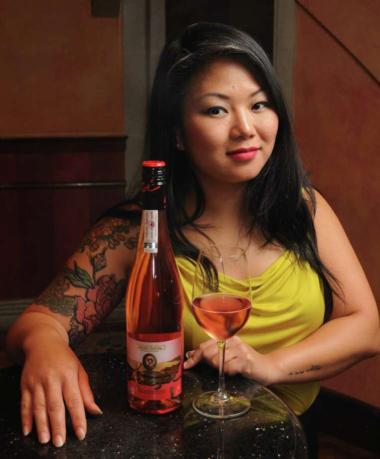 Mark's sommelier Cathy Nguyen with her wine choice Wednesday July 16, 2014. (Dave Rossman photo) Photo: Dave Rossman, Freelance / © 2014 Dave Rossman