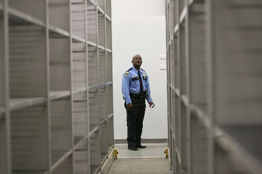 A Houston Police Department officer walks through the property room when it first opened in 2009. (Mayra Beltran / Houston Chronicle)