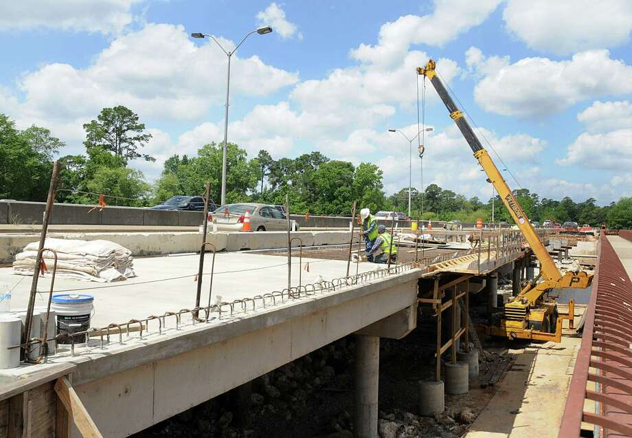 Workers prepare the Woodlands Parkway bridge, over Lake Woodlands, for concrete work. Construction on the bridge project was scheduled to be finished last December, but is way behind schedule. Photo by David Hopper Photo: David Hopper, For The Chronicle / freelance