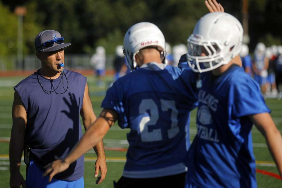 Varsity football coach Mike Ivankovich, left, trains players as they go through non-impact tackling drills at Acalanes High School football practice on Monday, July 21, 2014, in Lafayette, Calif. Photo: Carlos Avila Gonzalez, The Chronicle