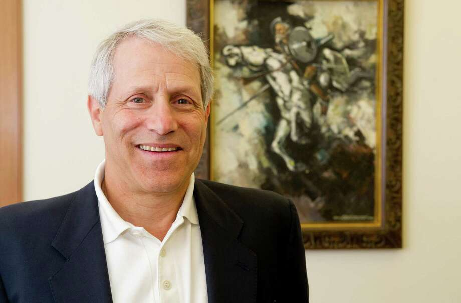 Rick Redniss, President of Redniss & Mead, poses for a photo in the company's Stamford office on Tuesday, July 22, 2014. Photo: Lindsay Perry / Stamford Advocate