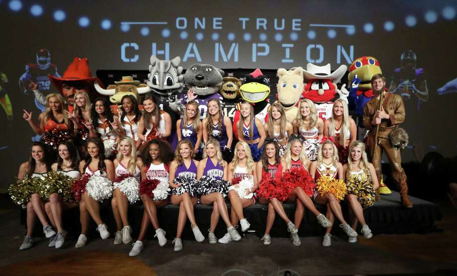 University cheerleaders and mascots poses for a photo on the main stage at the Big 12 Conference NCAA college football media days in Dallas, Tuesday, July 22, 2014. (AP Photo) Photo: Associated Press / AP
