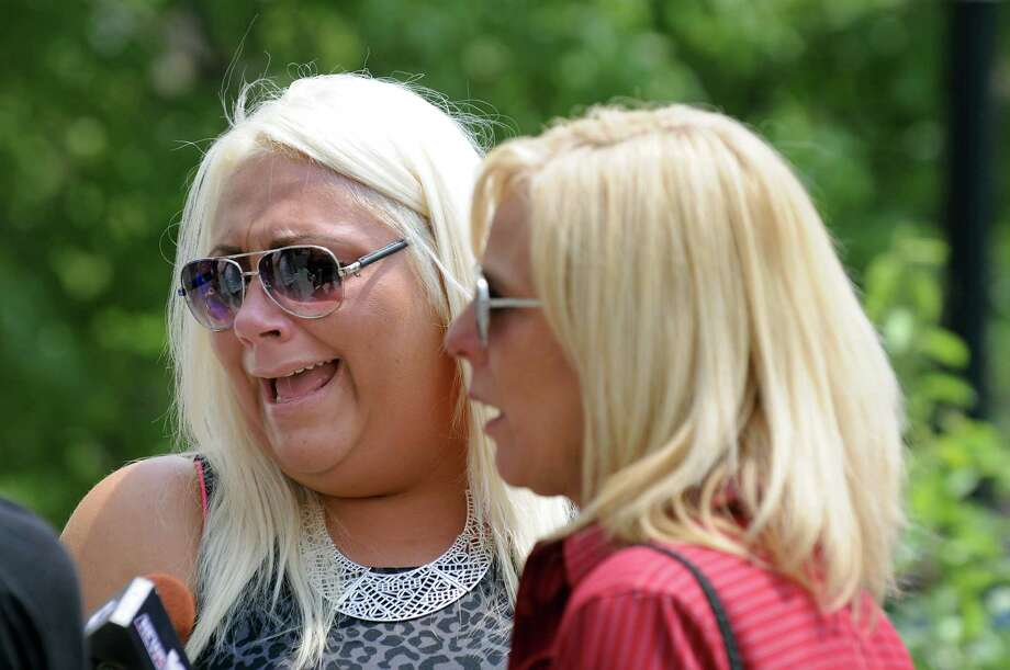 Tia Hayes, stepdaughter of victim Paul Merges, left, and Kristina Merges, his former wife, react to closing arguments in the trial of Pablo Cruz on Tuesday, July 22, 2014, at the Judicial Center in Albany, N.Y. (Cindy Schultz / Times Union) Photo: Cindy Schultz / 00027880A