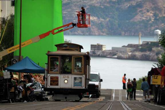 "A cable car rolls through the film set where a production crew prepares to shoot a scene for the film ""San Andreas"" on Hyde Street in San Francisco, Calif. on Tuesday, July 22, 2014. Actor Dwayne Johnson stars in the earthquake disaster movie scheduled to be released in 2015."