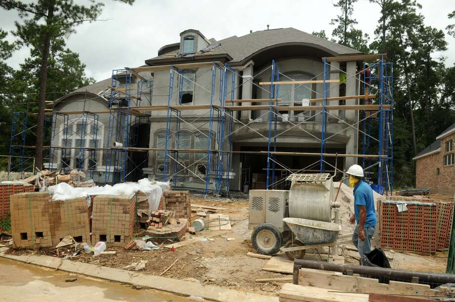 Home construction continues in Woodtrace, a master-planned community north of Tomball. The housing market around Spring, Klein and Tomball continues to boom. Photo: Jerry Baker, Freelance