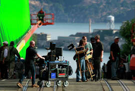 """A production crew prepares to shoot a scene for the film """"San Andreas"""" on Hyde Street last year."""
