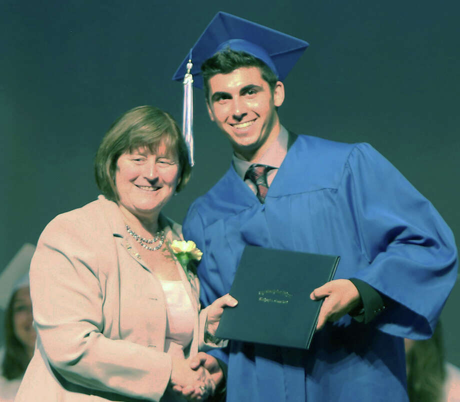 Mark Rainey, the 2014 Glenholme School student council president, is presented his diploma by Principal Sharon Murphy during the Washington school's recent graduation ceremony. June 2014  Courtesy of Glenholme School Photo: Contributed Photo / The News-Times Contributed